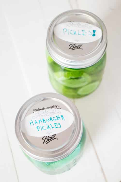 NO CANNING 24 Hour Refrigerator Hamburger Pickles! This easy recipe doesn't require vinegar and tastes just like the best dill pickles!  This is one of my favorite homemade recipes to use for our garden cucumbers! I love how crunchy the pickles are!