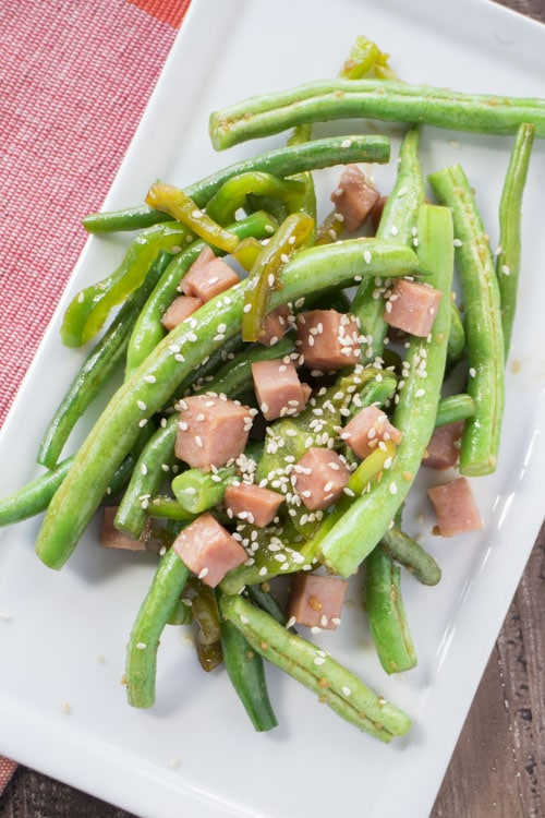 green bean with sesame seeds on top