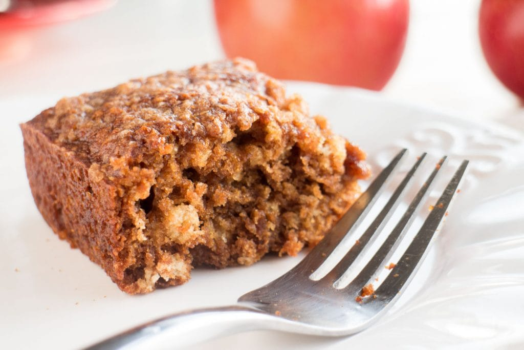 apple brownies on white plate with fork