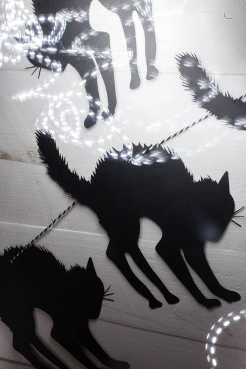 DIY on how to make black cat Halloween garland. Super easy to make with a die cut machine or laser cutter. All you need is paper and string!