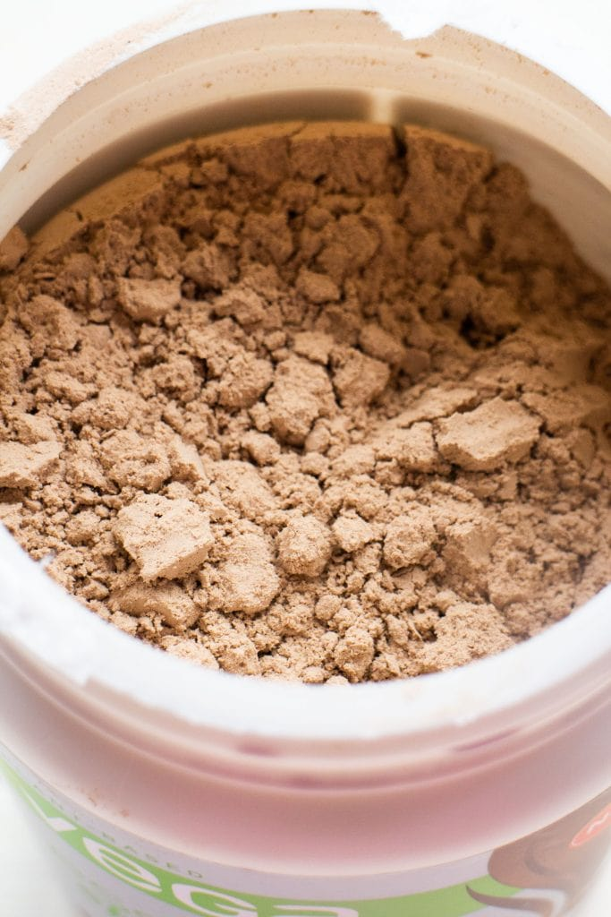 container of chocolate protein powder