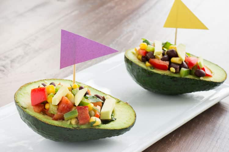 These Avocado Sailboats Filled With Mexican Corn Salad is a fun recipe that is perfect for parties!