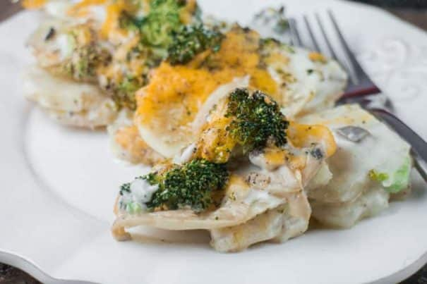 Cheesy Scalloped Potatoes and Broccoli with Cream of Mushroom Soup. These scalloped potatoes are light on the cheese and use a creamy cream of mushroom mixture. They will be a hit at the next holiday dinner!