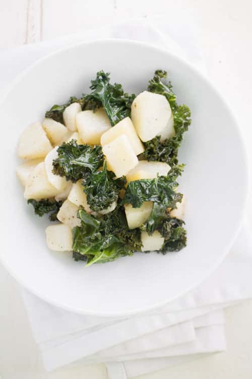 Easy recipe for Potatoes and Kale, a filling healthy vegetarian meal.  The ingredients are simple: potatoes, kale, olive oil and salt and pepper.