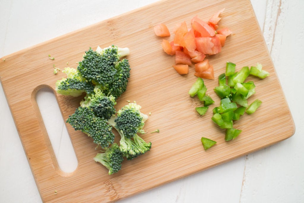 diced up vegetables on cutting board