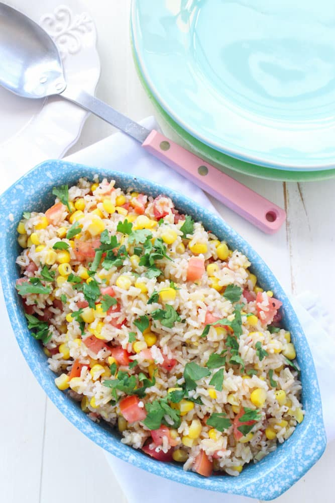This Corn and Tomato Rice Salad is a healthy recipe for dinner, picnics and potlucks.  With it's Mexican inspired flavor it'll be a hit with everyone!  And even better, it's easy to make in 15 minutes!