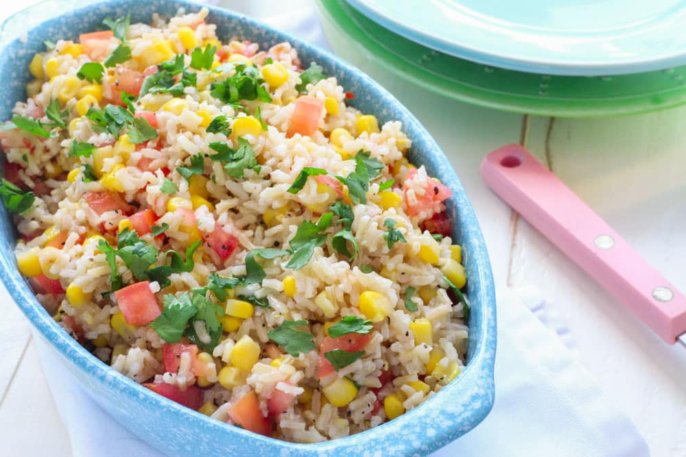 This Corn and Tomato Rice Salad is perfect for dinner, picnics and potlucks. With it's Mexican inspired flavor it'll be a hit with everyone! And even better, it's ready in 15 minutes!