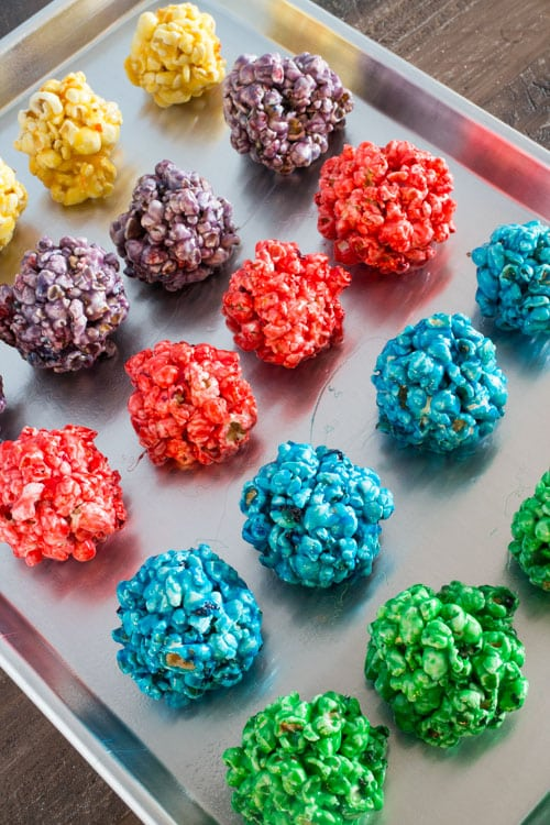 Follow these easy step by step instructions to make delicious Rainbow Popcorn Balls! They are fun to make for birthday parties, sleepovers, camping trips and dessert!