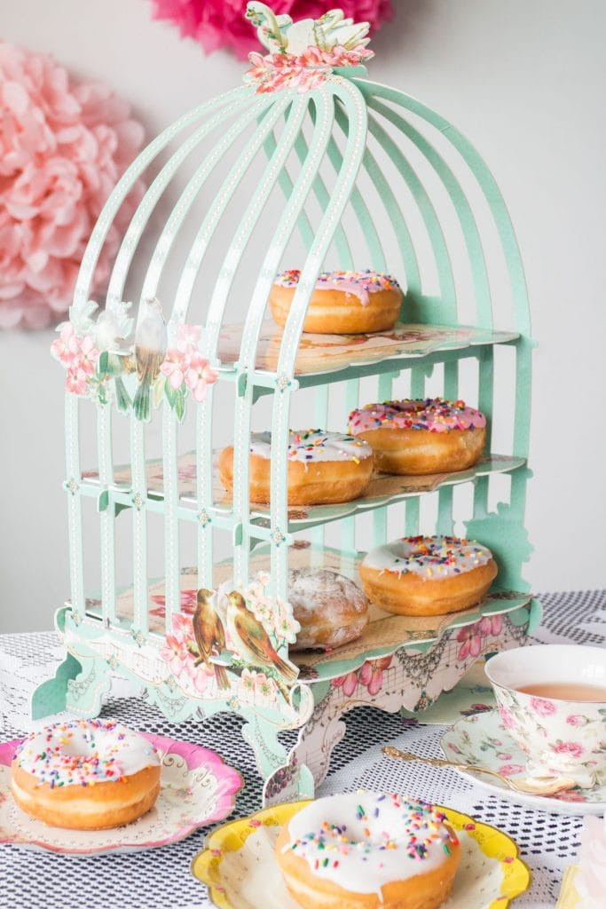 paper bird cage with donuts in it