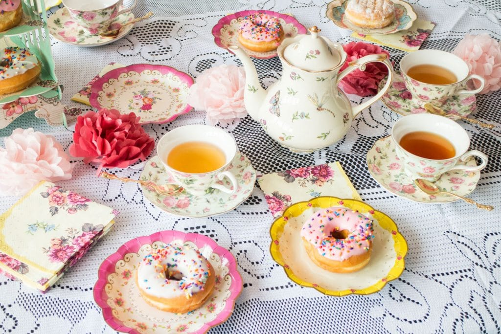 food and tea cups on lace table cloth for a tea party