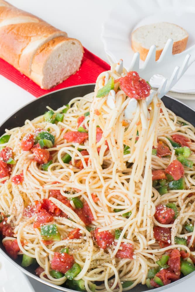 You'll never throw away leftover spaghetti again once you make this Leftover Spaghetti Skillet with Tomatoes and Green Peppers! It's so easy to bring your spaghetti back to life!
