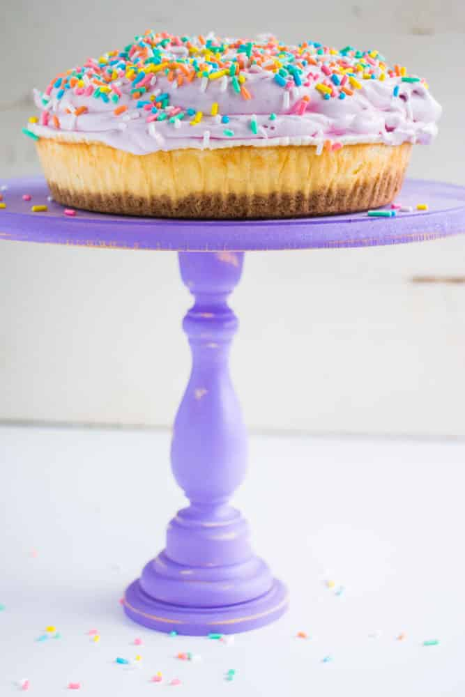 Blueberry Whipped Cream Cheesecake - a beautiful and delicious pastel sprinkled cake! The blueberries give the whipped topping it's pretty color.