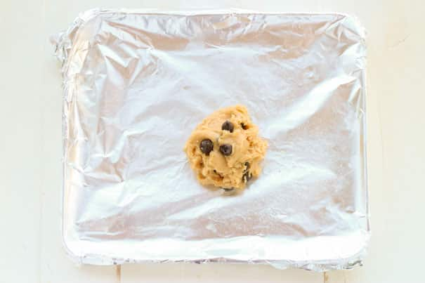 This delicious Single Serving Chocolate Chip Cookie recipe is the perfect little treat. This peanut butter chocolate chip one cookie recipe is thick, soft and chewy. My go-to for late night snacking when the cookie craving hits.