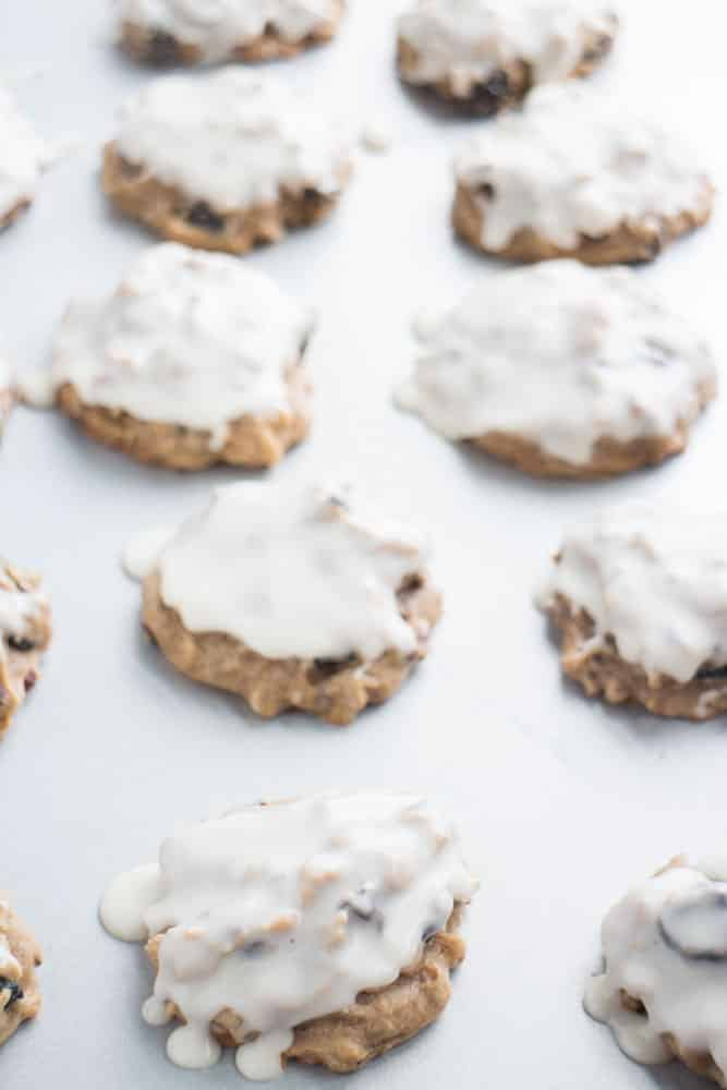These Coconut Raisin Chocolate Chip Cookies are so good! They have a delicious powdered sugar glaze on top! The cookies are loaded with raisins and pecans so they make the perfect snack!