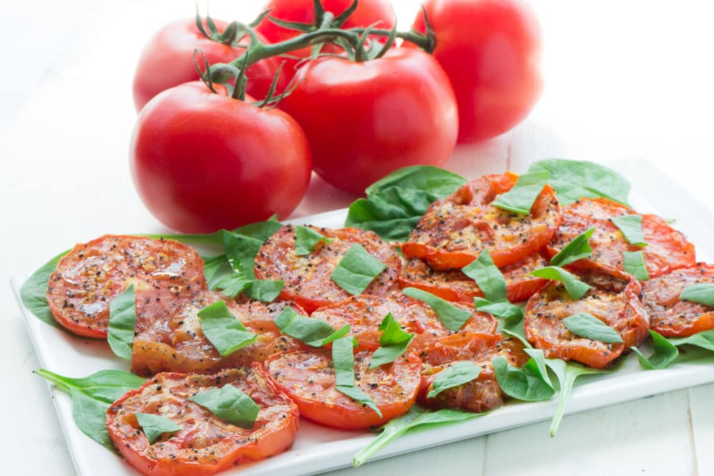 Fresh tomatoes are roasted with olive oil for 25 minutes to make this Roasted Tomato Salad. It's a perfect way to enjoy your fresh Summer tomatoes!