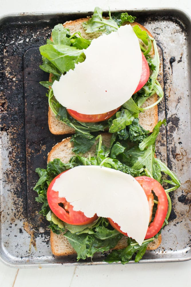 Healthy Kale Arugula Sandwich with Melted Cheese that is only 250 calories! This delicious open faced sandwich is perfect for lunch or a meatless dinner.