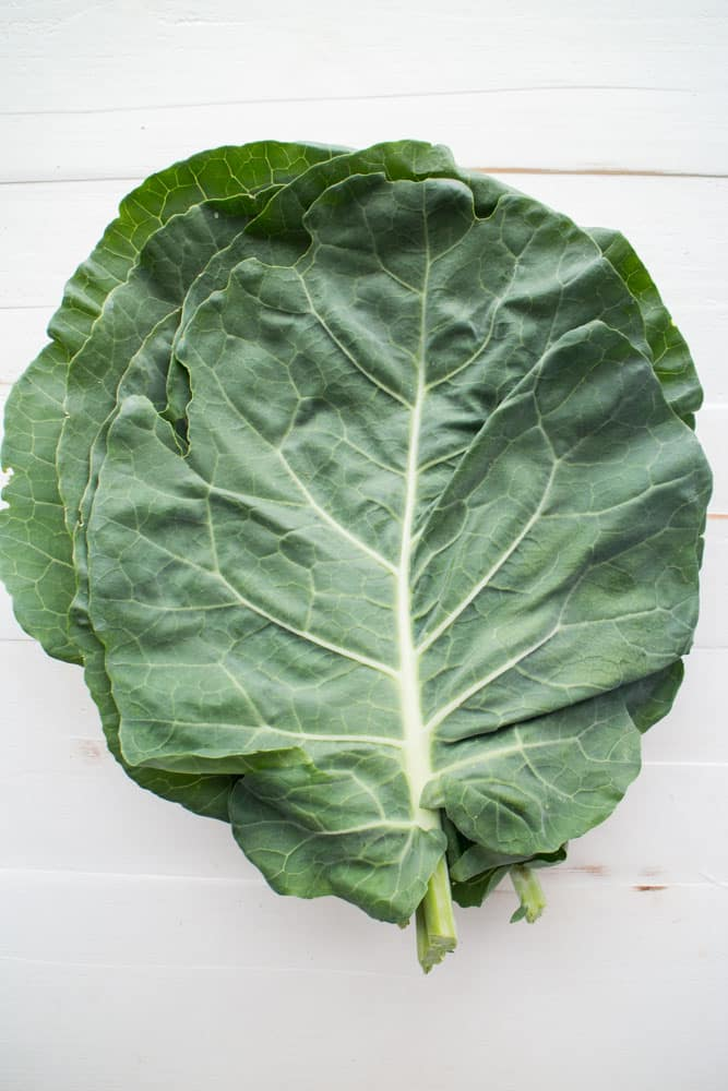 Simple Vegetarian Collard Greens recipe. These greens are simmered in a brown sugar vegetable broth making them full of flavor!