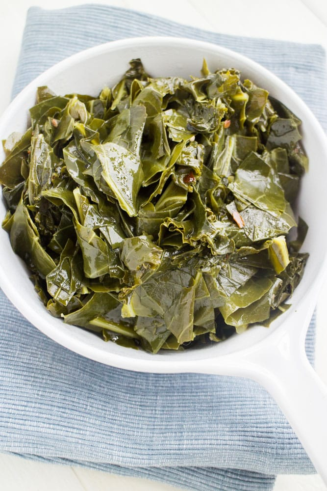 Easy Vegetarian Collard Greens recipe, these are the best! Collard greens are simmered in a brown sugar vegetable broth making them full of flavor!  Only 68 calories a serving making them healthy!