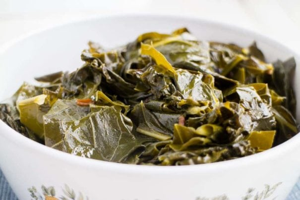 Easy Vegetarian Collard Greens recipe, these are the best! Healthy collard greens are simmered in a brown sugar vegetable broth making them full of flavor!  Only 68 calories a serving.