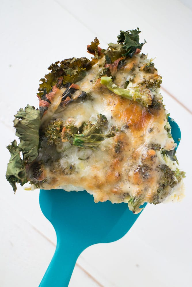 This Cheesy Broccoli Quiche is a easy to make dinner recipe! Instead of the traditional pie crust, we're using kale to line the bottom of the casserole dish. It's the perfect balance of cheesy and vegetables!