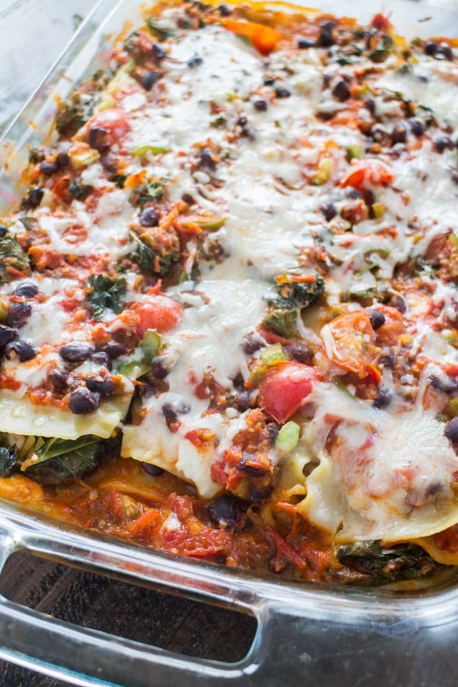 This MEXICAN VEGETARIAN LASAGNA Bake is filled with vegetables, noodles, ricotta and mozzarella cheese! Taco seasoning gives it a delicious Mexican flavor! This healthy meal recipe is easy to make and can be prepared ahead of time for a quick weeknight meal, all you have to do is bake it!