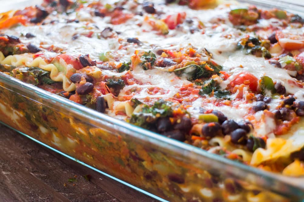 Mexican Vegetarian Lasagna recipe that is filled with veggies, ricotta and mozzarella cheese! Taco seasoning gives it a delicious Mexican flavor! This is easy to make and can be prepared ahead of time for a quick weeknight meal!