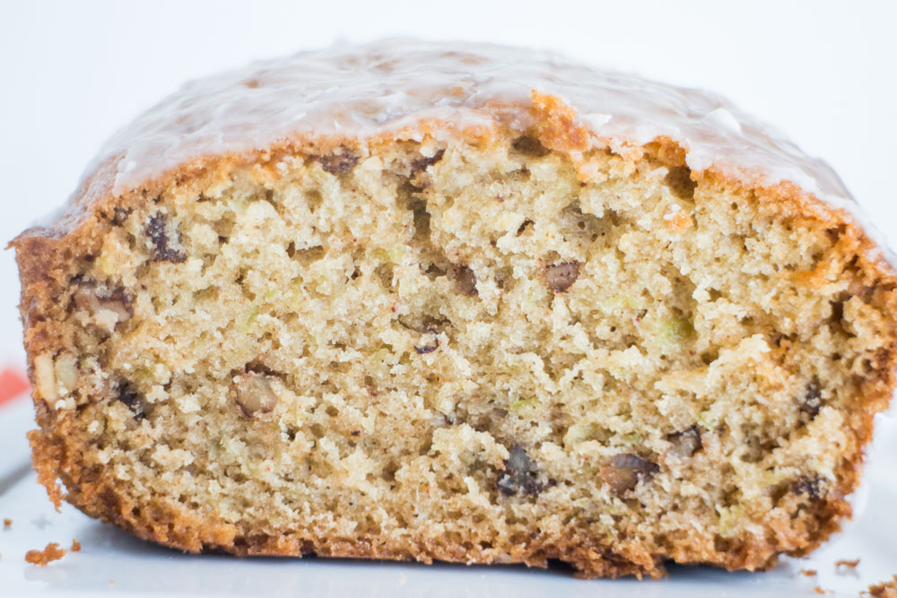 This Sugar Glazed CUCUMBER Bread is amazing and super moist! It tastes just like zucchini bread, but it's made with 1 cup grated cucumber. The healthy recipe is easy to make and is a great way to eat your vegetables! A powdered sugar glaze is poured on top once baked! Everyone in my family LOVES it!