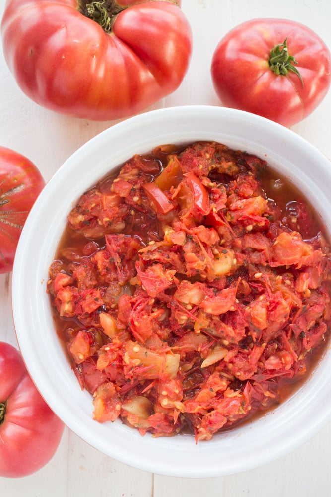 These Italian Diced Tomatoes are marinated overnight with spices for full flavor. Unlike other diced tomato recipes no boiling, water bath or peeling is needed!