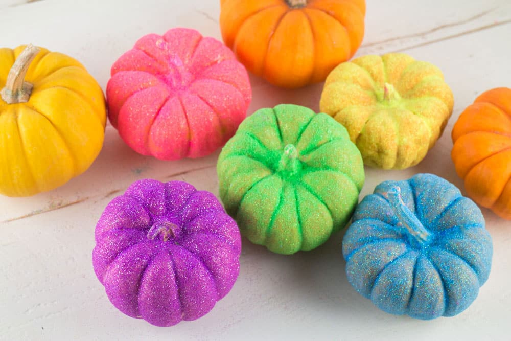 how to make rainbow glitter pumpkins follow these easy step by step instructions to add