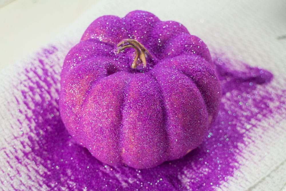 How to Make Rainbow Glitter Pumpkins. Follow these easy step by step instructions to add neon color to Halloween!