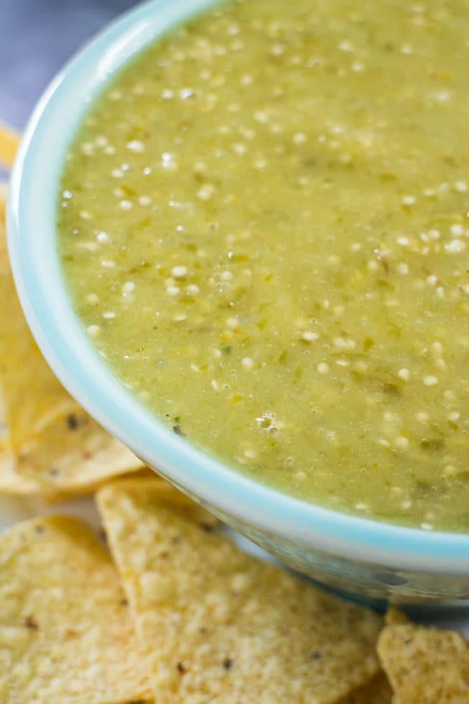 This recipe for Roasted Tomatillo, Onion & Jalapeno Salsa is delicious for dipping chips in! The vegetables are roasted in the oven which creates a creamy salsa!