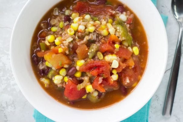 This vegetarian recipe for Slow Cooker Tomatillo Soup is a comforting meal filled with a hearty blend of black beans, rice, healthy vegetables and seasonings, all cooked to perfection. A comforting soup that you can feel good about eating!