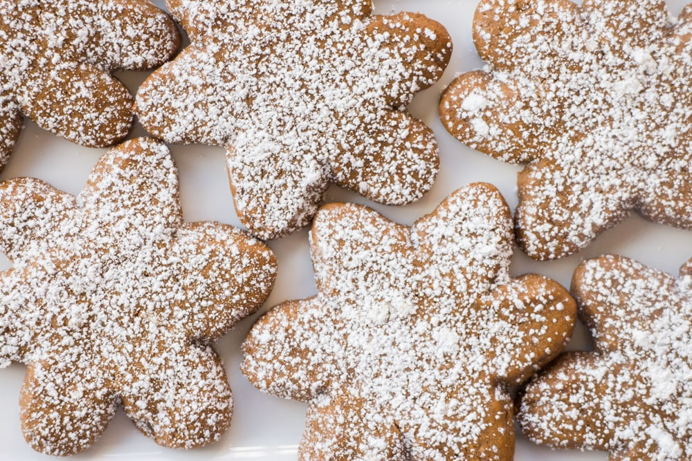 Gingerbread Cookies with Powdered Sugar sprinkled on top are one of my favorite holiday cookies. Unlike most gingerbread cookie recipes this one doesn't require you to chill the dough. Recipe makes 2 dozen cookies.