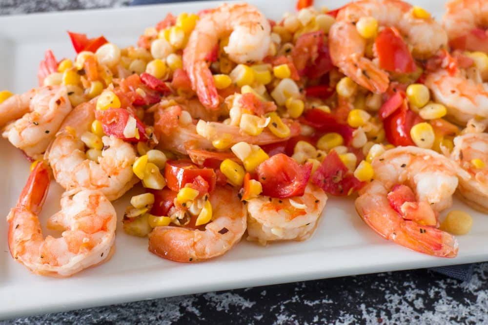 Easy to make Shrimp, Tomato & Corn Salad that is ready in 15 minutes. This is perfect to serve for dinner over pasta, as a appetizer or a light lunch.