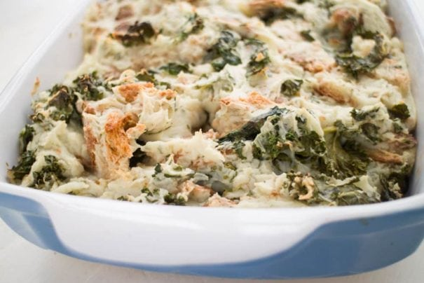 This Potato Kale Stuffing is a comfort food recipe that goes perfect with a chicken, pork chop or steak dinner. It's simple to make because it's made with instant potatoes! Potato Kale Stuffing is also always requested at Thanksgiving! The perfect hearty side dish for your holiday meal.