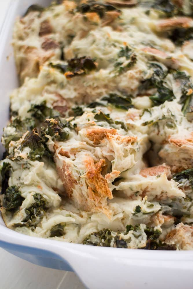 This Kale Potato Bread Stuffing is a comforting side dish that goes perfect with a chicken, pork chop or steak dinner. You'll love how the top is slightly crispy too!