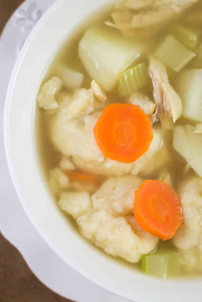 Easy to make recipe for Shredded Chicken Dumpling Soup with potatoes, carrots and celery. This soup is a healthy comfort food!