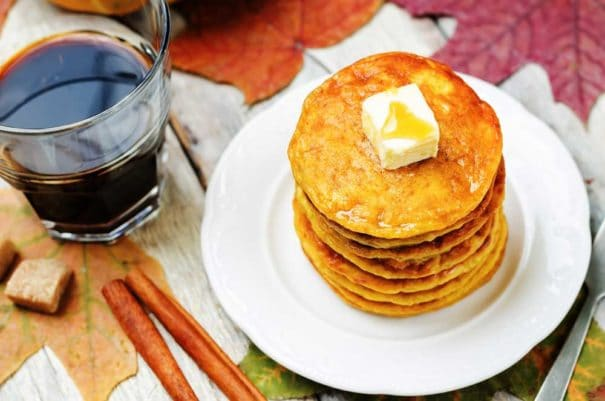 """EASY FLUFFY Pumpkin Pancakes recipe! These delicious extra fluffy pancakes made from scratch are low carb and packed with protein (1/2 cup pumpkin!). They make a healthy substitutioninstead of buttermilk pancakes. My family considers them """"the best pumpkin pancakes in the world!""""."""