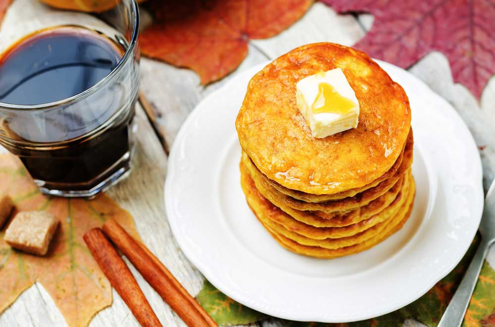 "You'll love how easy this Pumpkin Pancakes recipe is! These delicious extra fluffy pancakes made from scratch are low carb and packed with protein (1/2 cup pumpkin!). They make a healthy substitution instead of buttermilk pancakes. My family considers them ""the best pumpkin pancakes in the world!""."