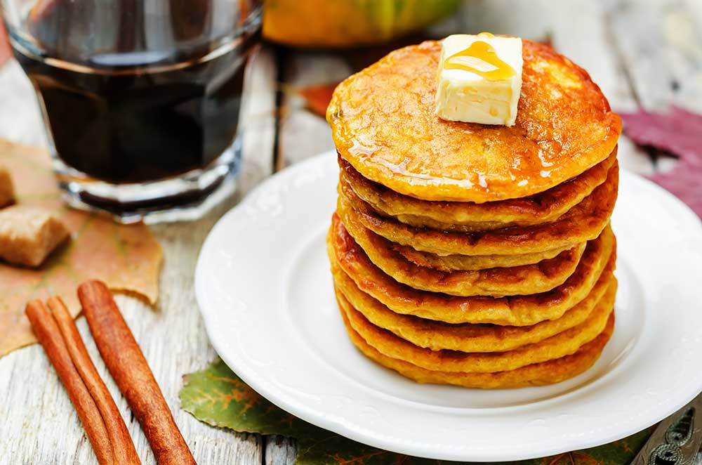 "EASY FLUFFY Pumpkin Pancakes recipe! These delicious extra fluffy pancakes made from scratch are low carb and packed with protein (1/2 cup pumpkin!). They make a healthy substitution instead of buttermilk pancakes. My family considers them ""the best pumpkin pancakes in the world!""."