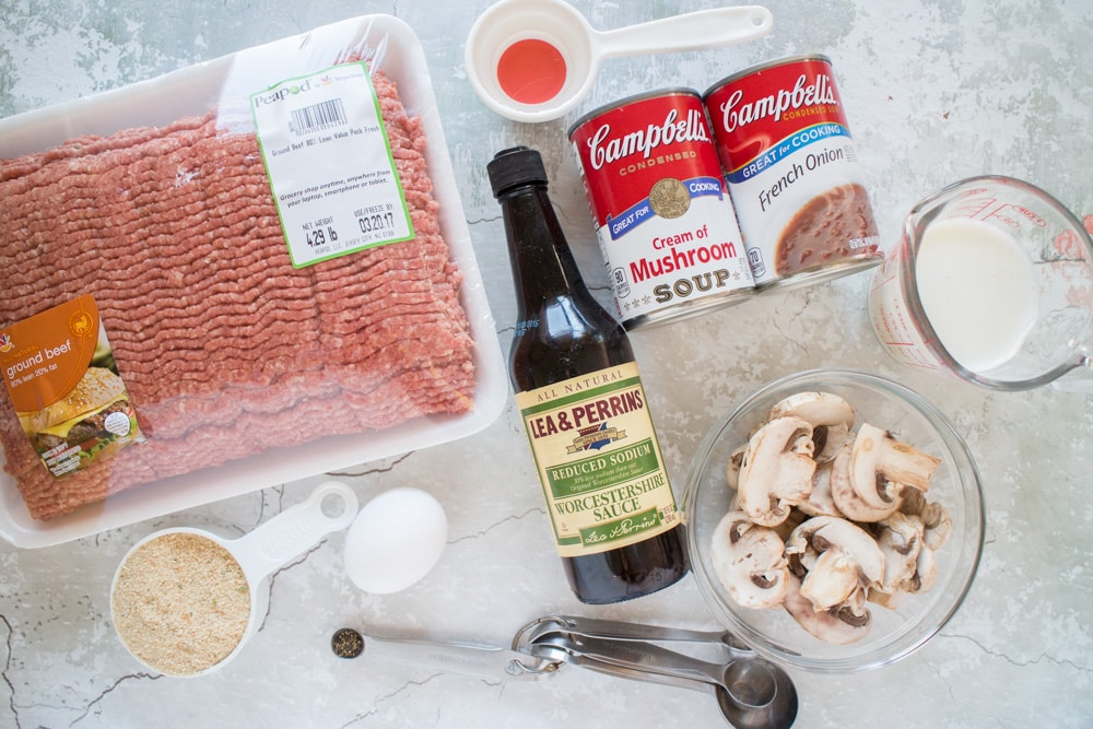 Make-Ahead Freezer Salisbury Steak recipe that makes a comforting family dinner! This easy to make recipe uses Cream of Mushroom Soup and French Onion Soup to create a creamy gravy to pour on top of the steak patties. All you have to do is bake it and freeze it and it'll be ready for weeknights when you don't have time to cook. Serve alongside mashed potatoes and veggies for a full dinner.