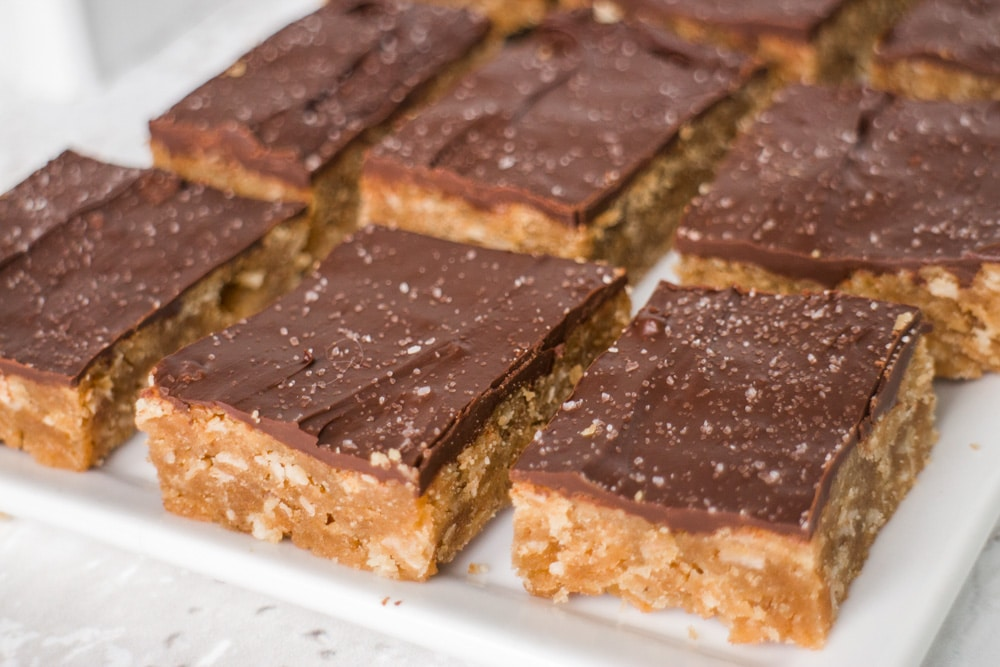 Yummy Peanut Butter Oatmeal Bars with Melted Chocolate Frosting on top. To keep it light on calories substitute 1/2 cup Stevia Blend instead of sugar.