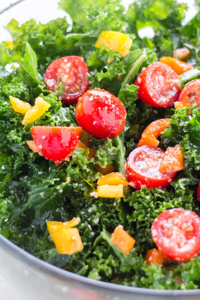 BEAUTIFUL Kale Rainbow Salad with olive oil and lemon dressing is the perfect healthy salad recipe! This easy salad includes massaged kale, grape tomatoes and colorful peppers to give it a pretty rainbow look! My family loves this salad for dinner in Summer and Winter, and it's great for a crowd!