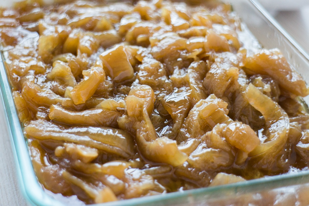 Easy Slow Cooker Caramelized Onions recipe that is ready in 5 hours.  This quick 4 ingredient recipe is the best and will make your mouth water!