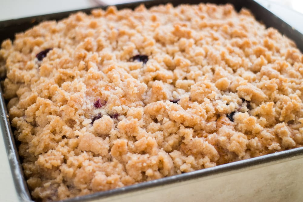 Easy to make Blueberry Buckle that tastes just like Coffee Cake!   This old fashioned cake recipe has a yummy cinnamon streusel topping that my family thinks is the best!  Enjoy for breakfast or dessert.  Made in a 8x8 pan, but can be doubled in a 9x13.