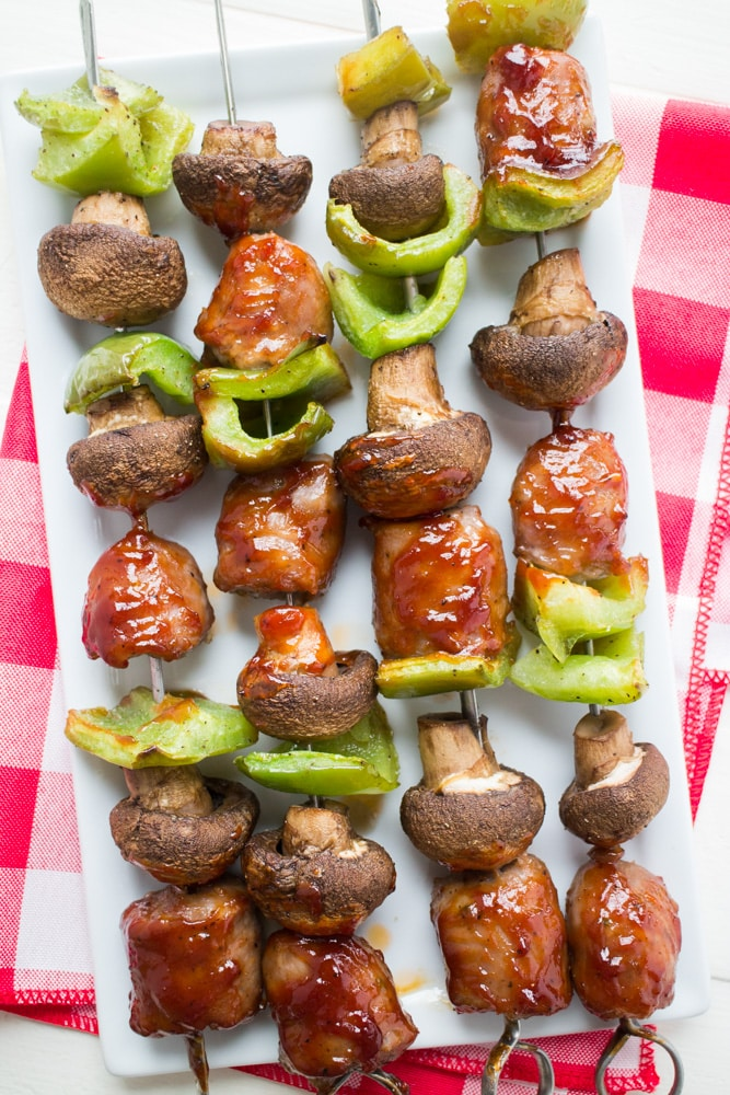 How to make BBQ Sausage Kabobs in the oven! This easy healthy recipe makes Oven Baked Sausage with mushrooms and peppers on sticks in the oven, no grill is needed!