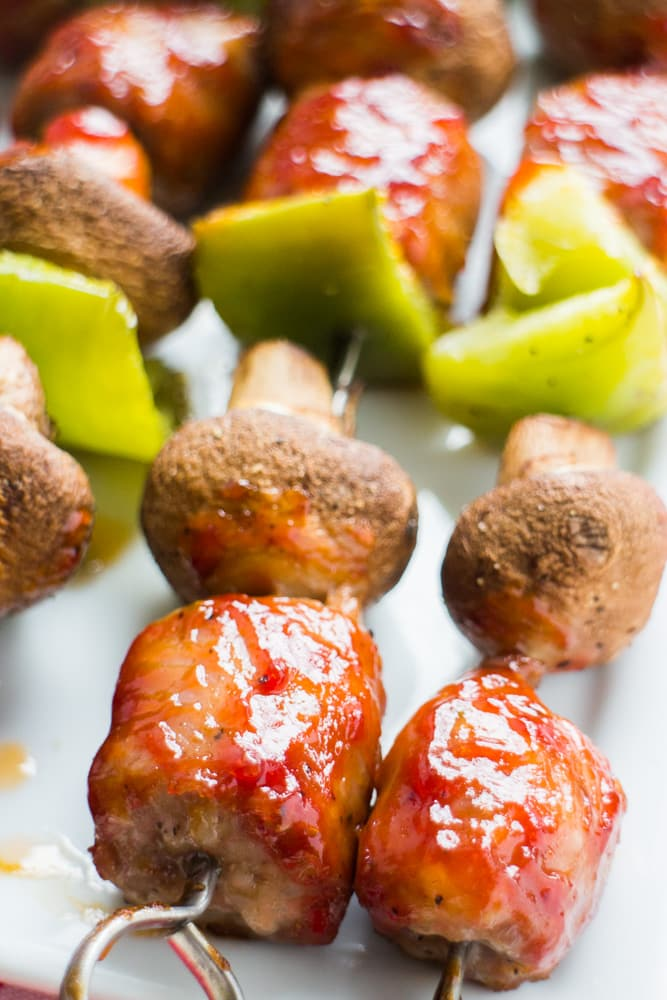 OVEN BAKED BBQ Sausage Kabobs with Mushrooms and Peppers are delicious! This easy healthy recipe bakes the meat and veggie kabobs in the oven so no grill is needed! The sausage has a coat of brown sugar BBQ sauce on it that is so tasty! These are my favorite year round Kabobs that my entire family loves!