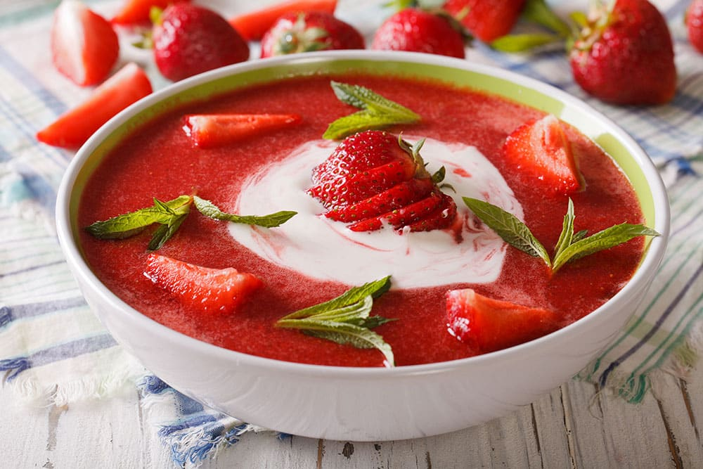 EAT HEALTHY WITH THIS EASY Strawberry Soup! This simple Summer time meal recipe uses fresh strawberries and yogurt to make a creamy chilled strawberry soup! Your entire family is going to love this healthy dish!
