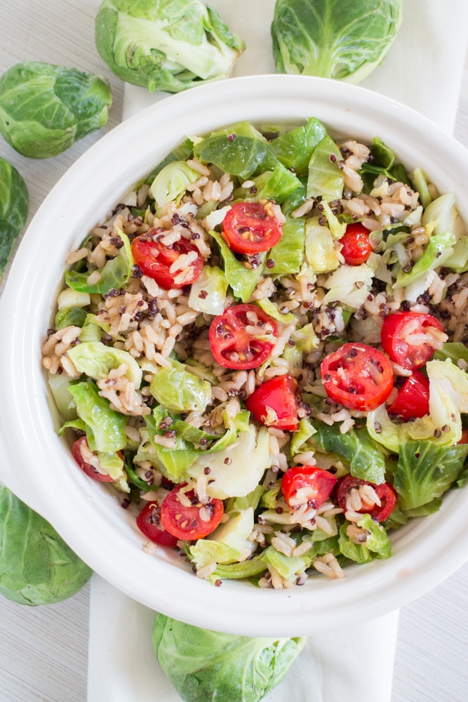 10 MINUTE Brussels Sprouts Quinoa Rice dish! This EASY clean eating recipe is made with Minute Rice and served with fresh Brussels Sprouts and cherry tomatoes! This healthy meal is gluten free and vegetarian - make it for a work lunch or easy dinner!