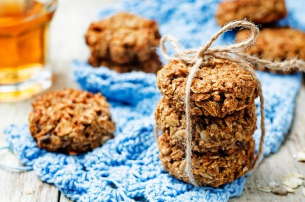 Banana Oat Cookies that taste just like banana bread! This healthy, easy to make recipe makes 3 dozen cookies filled with oatmeal, walnuts, and chocolate chips! These cookies are soft and packed with protein and fiber to make the best breakfast or dessert!